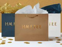 Vai trò của mẫu in túi giấy đựng áo sơ mi trong kinh doanh thời trang